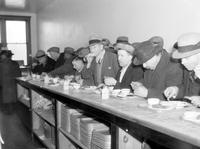 Volunteers of America. Serving Thanksgiving Dinner to unemployed