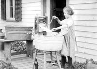 Wash-Day Scenes - Woman Fastening Clothes on Line - Girl Wringing Clothes