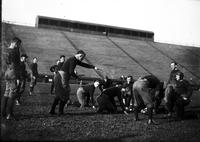Yost, Fielding. at football practice with team.