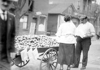 Peddlers; of fruit. Selling Watermelon.