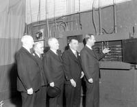 Automobiles; Shows; Detroit; 1934. -Joseph A. Schulte; H. H. Shuart; James M. O'Dea; John H. Thompson & Frank Couzens Turning on the Lights for the Show