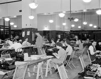 Federal Building; New. Interior View. Showing Asst. Postmast Wiggle & staff making out bonus checks.