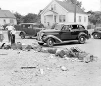 Streets; Fenolon & Sobieski Avenue. . Residents Block Street to force to to oil unpaved surface. 4x5