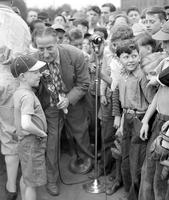 Schools; Baseball. Mayor reading at opening of North Western Baseball School with Harry Heilmann, Chief Instructor . Crowds. Ty Tyson interviewing small boy.
