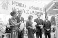Astronauts; Crew of Apollo 15 Flight to Moon. -At University of Michigan Stadium. -Left to Right; Will Perry of Alumni, Colonel David R. Scott, Major Alfred M. Worden & Lieutenant Colonel James B. Irwin