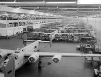 "Ford Motor Co. ; Plants; Willow Run. Production of Consolidated B-24 ""Liberators"". Workers on Fuselage Section eating lunch"