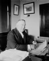 Newberry, Truman H. Politician, Capitalist. Sitting at desk.