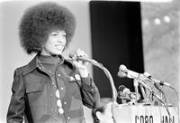 Davis, Angela: Black Activist. - Photos- 2/24/1974 at her appearance at Cobo Hall in Detroit at Rally. (With Clyde Bellecourt)