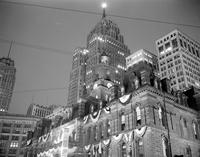 Automobiles; History; Detroit; Jubilee. City Hall Tower Day and night scenes .