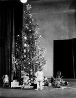 Christmas Scenes; Christmas Trees. Children looking at tree and toys. .