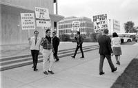 New Detroit Committee. Detroit Area Leaders Form Committee to combat conditions that led to race riot of July 1967. Picketers.