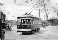 Street railways; Trackless trolley. First model in Detroit in 1925. with shot of picking up passenger. electric trolley.