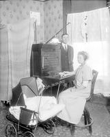 Michigan; Cities; Brooklyn. Bldg. exteriors. with a Man, woman, baby carriage near switchboard