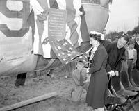 Ford, Edsel; Memorials. Bomber dedicated to Edsel Ford. Mrs. Walter Buhl Ford II unveils the B-24 Bomber.