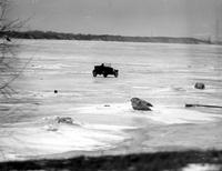 Prohibition; Smuggling; Winter Scenes. Rum-runners Bringing Booze Across River in Sleds & Autos