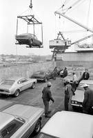 Ford Motor Co. Capri models. Ford Capris, made in Germany, being unloaded at Detroit Harbor terminals. 6 negs