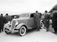 Ford Motor Co. Henry & Edsel Ford looking at 1934 model.