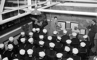 Ford Motor Co. ; Naval Training Program. Industrial scenes. Arrival of recruits.