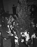 Christmas; Detroit; Children. Beside tree. Danish Christmas Party.