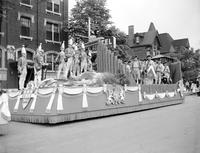 Detroit; History; 250th Birthday; Parade; Floats. -Packard Motor Car. -State Fair. -Steuben Soc. of America. -Univ. of Detroit. -Booker T. Washington. -Wayne Univ. -Saks Fifth Avenue.