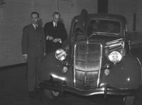 Ford Motor Co. ; Models; 1935 Ford Car. Henry and Edsel Ford and W. R. Campbell group around a car