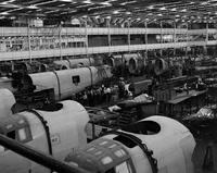"Ford Motor Co. ; Plants; Willow Run. Construction of Consolidated B-24 ""Liberators"". Men riveting on a wing section"