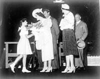 Great Britain; Royal Family; King George VI & Queen Elizabeth; In Windsor June 6, 1939; On Platform. -Receiving Bouquet from Mayor Croll's Daughter