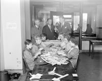 Wars; World; # 2; Air Raids. -Boys and Girl Scouts Making Paper Bombs. -M 25; Edward Lines, Donald Haraga, Walter Alexander, Boy Scouts, Joan Kolynak, Beverly Chambers, Jeanne Gassman, Girl Scouts. -Standing; Frank Atherton, Lieutenant Bernard A. Peo & Frank M. Malaury