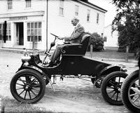 Ford Motor Company; Anniversary; 40th. -Henry Ford Driving Old Model Car