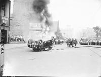 Riots; Detroit; Race Riots. Burning & Wrecked Autos. Rioters running from tear gas