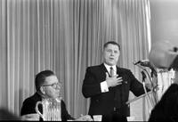 Hoffa, James R. ; Labor Leader. Addresses rally at Cobo ordering wildcat strikers to go back to work with Frank Fitzsimmons (seated).