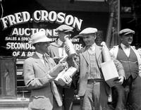 prohibition; Canada. people buying and carrying booze.